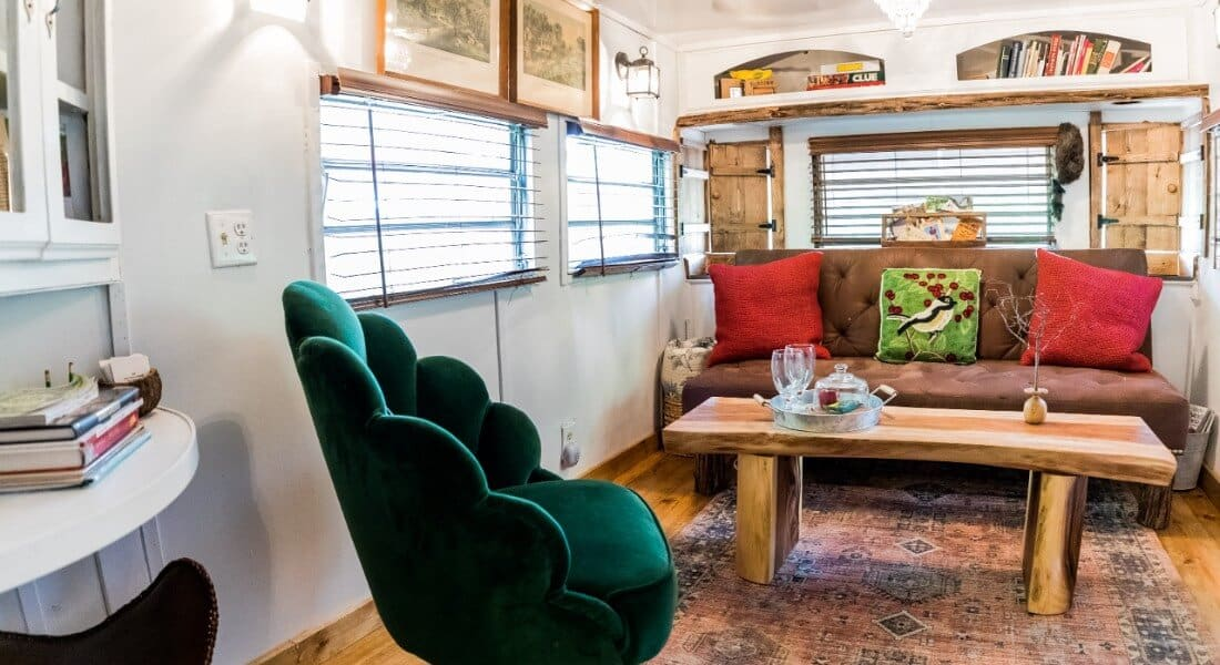 Living room area of Airstream trailer with sofa, chair and coffee table.